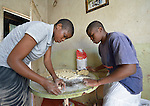 Caroline Mandishona (right) prepares pastries to bake in her home in Bulawayo, Zimbabwe. On the left is her sister Catherine. Mandishona suffered cerebral palsy and uses a wheelchair provided by the Jairos Jiri Association with support from CBM-US.