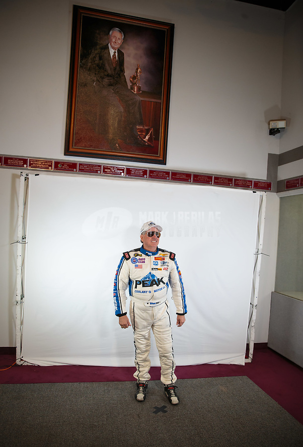 Feb 6, 2019; Pomona, CA, USA; NHRA funny car drivers John Force stands beneath a painting of NHRA founder Wally Parks during NHRA Media Day at the NHRA Museum. Mandatory Credit: Mark J. Rebilas-USA TODAY Sports
