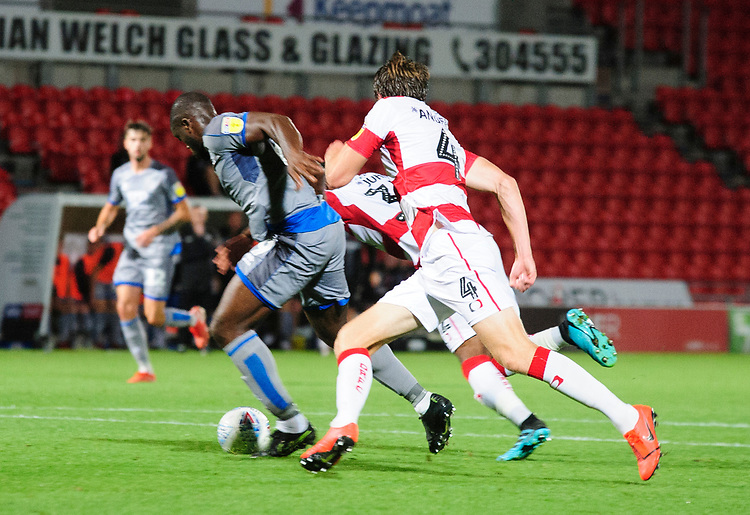 Lincoln City's John Akinde beats Doncaster Rovers' Ben Sheaf to score the opening goal<br /> <br /> Photographer Andrew Vaughan/CameraSport<br /> <br /> EFL Leasing.com Trophy - Northern Section - Group H - Doncaster Rovers v Lincoln City - Tuesday 3rd September 2019 - Keepmoat Stadium - Doncaster<br />  <br /> World Copyright © 2018 CameraSport. All rights reserved. 43 Linden Ave. Countesthorpe. Leicester. England. LE8 5PG - Tel: +44 (0) 116 277 4147 - admin@camerasport.com - www.camerasport.com