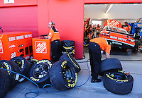 Feb 29, 2008; Las Vegas, NV, USA; A crew member for NASCAR Sprint Cup Series driver Tony Stewart inspects Goodyear Tires during practice for the UAW Dodge 400 at Las Vegas Motor Speedway. Mandatory Credit: Mark J. Rebilas-US PRESSWIRE