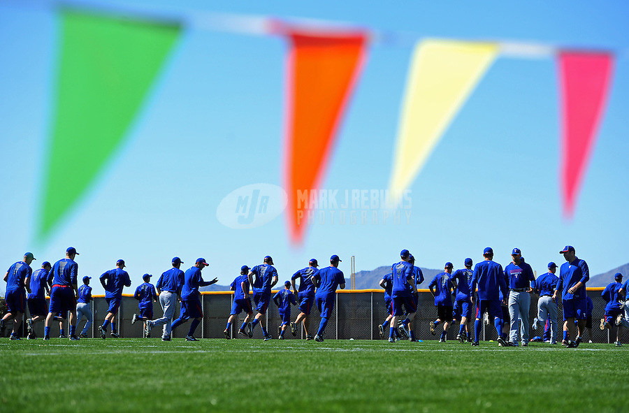 Mar. 2, 2012; Surprise, AZ, USA; Texas Rangers players run sprints prior to an intrasquad game on the practice fields at Surprise Stadium.  Mandatory Credit: Mark J. Rebilas-.