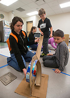 NWA Democrat-Gazette/BEN GOFF @NWABENGOFF<br /> Theresa Higson (from left), Scott Family Amazeum programs educator, Austin Schutz, 7, and Mason Wood, 8, try to get a Hot Wheels car to go through a loop made from recycled materials Wednesday, March, 21, 2018, during the &quot;Wheels, Wings &amp; Motorized Things&quot; Spring Break camp at the Scott Family Amazeum in Bentonville. The camp, inspired by the museum's temporary exhibit Hot Wheels: Race to Win, gives campers hands on opportunities to explore elements of physics such as gravity, friction and momentum.