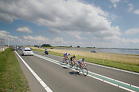 breakaway group across the Dutch Dikes<br /> <br /> Eneco Tour 2013<br /> stage 3: Oosterhout - Brouwersdam (187km)