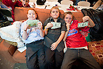 Christmas Eve Vigil Service at St. Sava Serbian Orthodox Church, Jackson, Calif.--young boys show gifts of two dollar bills