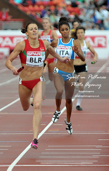 I Khliustava (BLR) leads M Chigboglu (ITA). Womens 4 x 400m. Day 2. European Team Athletics Championships. Gateshead. Tyne and Wear. UK. 23/06/2013. <br />  MANDATORY Credit Garry Bowden/SIPPA - NO UNAUTHORISED USE - 07837 394578