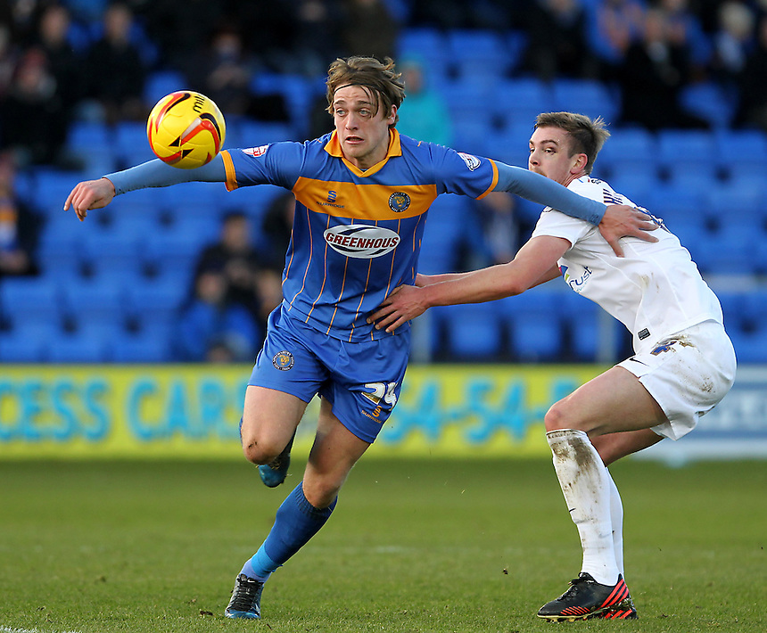 Preston North End's Paul Huntington battles with  Shrewsbury Town's Tom Eaves<br /><br />Photo by Mick Walker/CameraSport<br /><br />Football - The Football League Sky Bet League One - Shrewsbury Town v Preston North End - Sunday 29th December 2013 - Greenhous Meadow - Shrewsbury<br /><br />&copy; CameraSport - 43 Linden Ave. Countesthorpe. Leicester. England. LE8 5PG - Tel: +44 (0) 116 277 4147 - admin@camerasport.com - www.camerasport.com