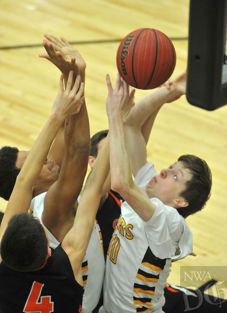 NWA Democrat-Gazette/MICHAEL WOODS &bull; @NWAMICHAELW<br /> Prairie Grove's Cameron Simmons tries to drive to the hoop  past Gravette defenders Tuesday January 26, 2016 during their game at Prairie Grove High School.