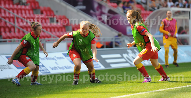 The Wales subs do a bit of warming up during the UEFA Womens U19 Championships at Parc y Scarlets, Monday 19th August 2013. All images are the copyright of Jeff Thomas Photography-www.jaypics.photoshelter.com-07837 386244-Any use of images must be authorised by the copyright owner.