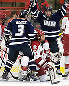 Austin Block (UNH - 3), Danny Fick (Harvard - 7), Kevin Goumas (UNH - 27) - The Harvard University Crimson defeated the University of New Hampshire Wildcats 7-6 on Tuesday, November 22, 2011, at Bright Hockey Center in Cambridge, Massachusetts.