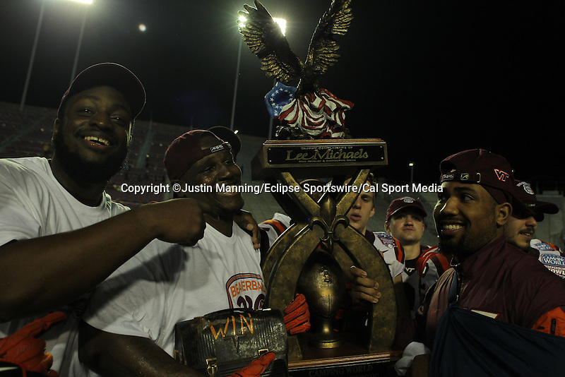 December 26, 2015: Virginia Tech players holding up the trophy after winning the Camping World Independence Bowl at Independence Stadium in Shreveport, LA. Justin Manning/ESW/CSM