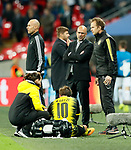 Dortmund's Peter Bosz looks at the injured Mario Gotze during the champions league match at Wembley Stadium, London. Picture date 13th September 2017. Picture credit should read: David Klein/Sportimage