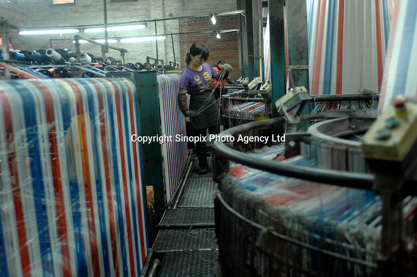 Worker at The Five Star Factory that manfactures plastic bags and plastic sheeting in Nanhai, China. The company uses recycles platic bags to make its products..15 Mar 2007