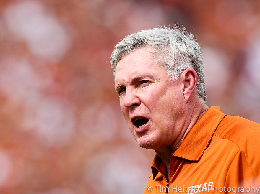 Oct 13, 2012; Dallas, TX, USA; Texas Longhorns head coach Mack Brown shoots at his team in the first quarter against the Oklahoma Sooners during the red river rivalry at the Cotton Bowl. Mandatory Credit: Tim Heitman-US PRESSWIRE