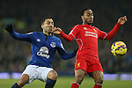 Aaron Lennon of Everton tussles with Raheem Sterling of Liverpool- Barclays Premier League - Everton vs Liverpool - Goodison Park Stadium  - Liverpool - England - 7th February 2015 - Picture Simon Bellis/Sportimage