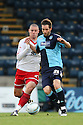 Michael Bostwick of Stevenage and John Halls of Wycombe challenge. - Wycombe Wanderers v Stevenage - Adams Park, High Wycombe - 31st December 2011  .© Kevin Coleman 2011
