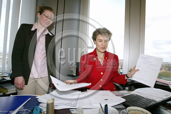BRUSSELS - BELGIUM - 29 APRIL 2004--MEP Astrid THORS (Fin/ELDR).-- Astrid THORS (R) in her office with her assistant Linda LINDHOLM going through papers and documents. -- PHOTO: JUHA ROININEN / EUP-IMAGES