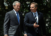 U.S. President George W. Bush and British Prime Minister Tony Blair walk on the South Lawn of the White House en route to a news conference July 28, 2006.   (UPI Photo/Roger L. Wollenberg)
