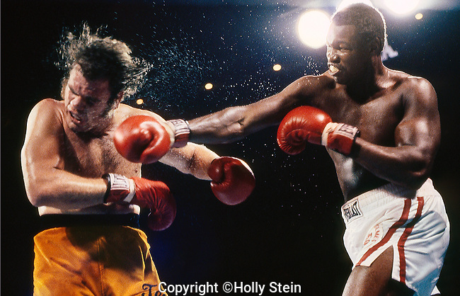 "Larry Holmes throws a right at Randall ""Tex"" Cobb during their WBC heavyweight title fight.  Holmes WUD 15."