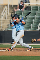 Alex Kowalczyk (22) of the Hickory Crawdads follows through on his swing against the Kannapolis Intimidators in game one of a double-header at Kannapolis Intimidators Stadium on May 19, 2017 in Kannapolis, North Carolina.  The Crawdads defeated the Intimidators 5-4.  (Brian Westerholt/Four Seam Images)