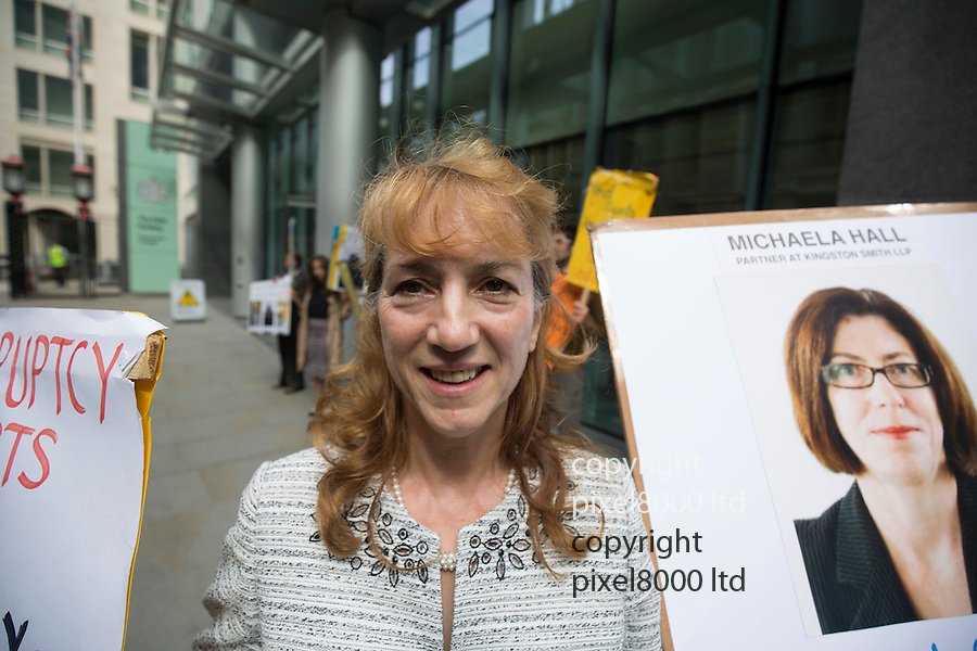 pic shows:: Dr Sheida Oraki demonstrates outside  the High Court in London today in her case against Dean and Dean solicitors <br /> <br /> <br /> <br /> <br /> Pic by Gavin Rodgers/Pixel 8000 Ltd