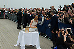 Jessica Chastain sign the guestbook in front of her dedicated beach locker room on the Promenade des Planches on September 5, 2014 in Deauville, France