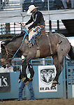 Taos Muncy competes in the saddle bronc event at the Reno Rodeo, in Reno, Nev. on Friday night, June 22, 2012..Photo by Cathleen Allison