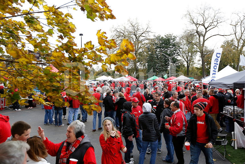 Tailgaters enjoy a brisk fall afternoon prior to the NCAA football game against Rutgers at Ohio Stadium in Columbus on Oct. 18, 2014. (Adam Cairns / The Columbus Dispatch)