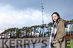 Local resident Catherine Quilter of Derra Listowel standing near the mobile mast in Derra on the Listowel to Ballybunion road on Tuesday, that is causing concern.