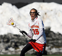 Brittany Jones (25) of Maryland looks for an open pass at the practice turf field in College Park, Maryland.  Maryland defeated Richmond, 17-7.