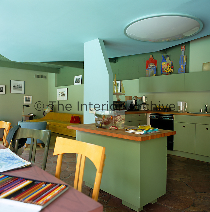 A living area that comprises sitting room, dining table and kitchen