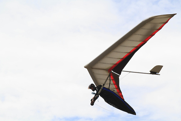 Male hang glider pilot taking off from Lookout Mountain in the foothills west of Denver, Colorado, USA .  John leads private photo tours in Boulder and throughout Colorado. Year-round.