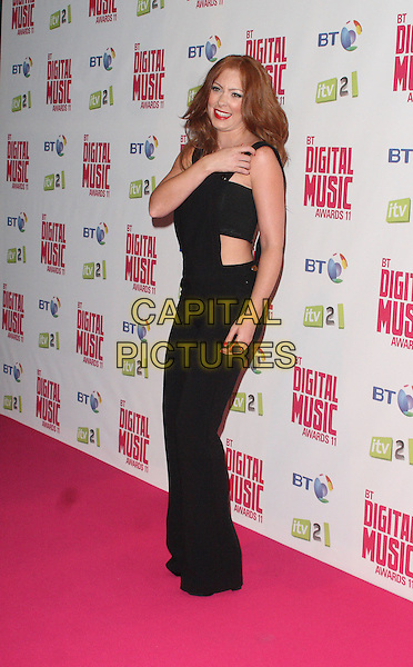 Natasha Hamilton.BT Digital Music Awards held at the Roundhouse, Chalk Farm, London, England..September 29th 2011.full length black overalls dungarees boob tube belly stomach midriff side hand arm.CAP/JIL.©Jill Mayhew/Capital Pictures