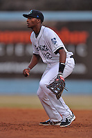Asheville Tourists first baseman Correlle Prime #32 during a game against the Delmarva Shorebirds at McCormick Field on April 4, 2014 in Asheville, North Carolina. The Shorebirds defeated the Tourists 7-2. (Tony Farlow/Four Seam Images)