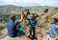 Owner of Rocky Mountain Slackline Dakota Collins (left), congratulates Adventurist columnist, Clint Carter after an attempt of a highline walk at North Tale Mountain in Golden, Colorado, Tuesday, August 29, 2017. Carter take on a vertigo-inducing highline that stretches across a traverse after only 4 days of training.<br /> <br /> Photo by Matt Nager