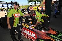 May 21, 2011; Topeka, KS, USA: NHRA top fuel dragster driver Terry McMillen with crew members during the Summer Nationals at Heartland Park Topeka. Mandatory Credit: Mark J. Rebilas-