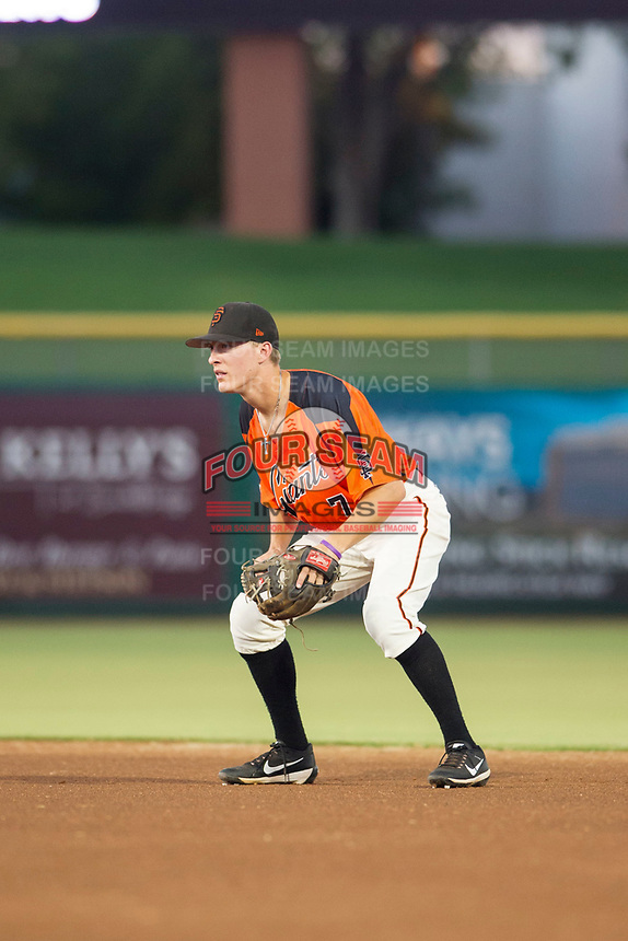 AZL Giants second baseman Kyle McPherson (7) on defense against the AZL Rangers on August 22 at Scottsdale Stadium in Scottsdale, Arizona. AZL Rangers defeated the AZL Giants 7-5. (Zachary Lucy/Four Seam Images via AP Images)