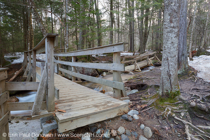 """""""The Basin"""" in Franconia Notch State Park of Lincoln, New Hampshire USA during the spring months. Flooding caused damage to the area"""