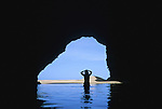 Exploring an ocean front cave at Kalalau beach on the Napali Coast Trail in Kayaii, Sept 26, 2002