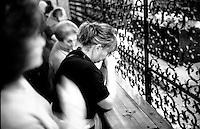 Italia, San Giovanni Rotondo (FG). <br /> Pellegrini in preghiera sulla tomba di Padre Pio nella cripta della chiesa di Santa Maria Delle Grazie.<br /> Italy, San Giovanni Rotondo (FG). <br /> Pilgrims in front of Padre Pio tomb.