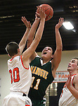 Tony Teglia shoots for Manogue against Douglas defenders Austin Evans, left, and James Herrick during a boys basketball game between Bishop Manogue and Douglas High in Minden, Nev., on Thursday, Dec. 22, 2011..Photo by Cathleen Allison