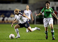 Irish midfielder Jemma Connor (14) trips up US defender Lori Chalupny (17).  The US Women's National Team defeated Ireland 2-0 at Toyota Park in Bridgeview, IL on September 20, 2008.  Photo by Tracy Allen/isiphotos.com