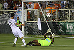 29 May 2012: Los Angeles' Pat Noonan (11) sends the ball over Carolina's Ray Burse (right) and the goal late in stoppage time on a chance to tie the game. The Carolina RailHawks (NASL) defeated the Los Angeles Galaxy (MLS) 2-1 at WakeMed Soccer Stadium in Cary, NC in a 2012 Lamar Hunt U.S. Open Cup third round game.