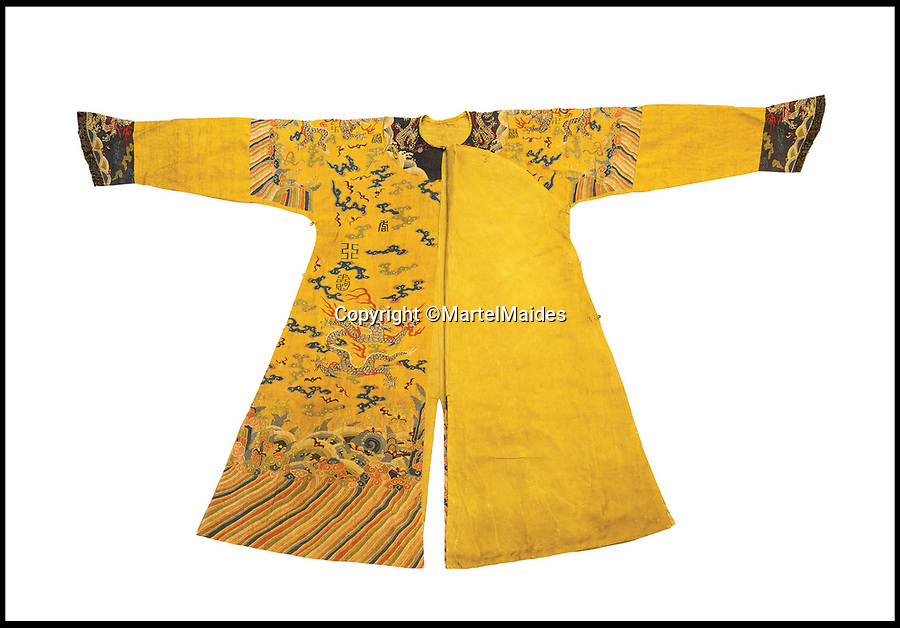 BNPS.co.uk (01202 558833)<br /> Pic: MartelMaides/BNPS<br /> <br /> Ker-Qing - Emperors OLD clothes that will cost you a whopping £60,000...<br /> <br /> The extraordinary yellow dragon robe which actually belonged to a revered Chinese emperor has emerged for sale for £60,000.<br /> <br /> The intricately detailed robe is believed to have been worn by the Jiaqing Emperor who ruled from 1796 to 1820.<br /> <br /> In Imperial China, only an emperor was allowed to wear yellow as it was seen as the most beautiful and important of all colours, which would also adorn royal palaces, altars and temples.<br /> <br /> The robe, which dates from about 1800, is made out of Kesi silk and has nine silver five clawed dragons on it.