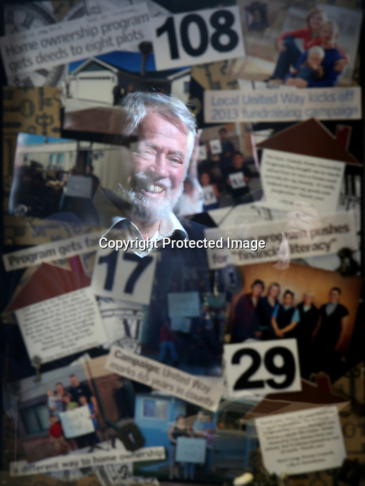 "Community volunteer Terry Williams' image is reflected in a collage of photographs, newspaper clippings and keys in the Wyoming Tribune Eagle photography studio earlier this month. After retiring from the state Williams founded the Wyoming Family Home Ownership Program which has placed 17 families in homes. The program is currently preparing, mentoring and educating 29 more families for home ownership. Williams said of living in Cheyenne ""Laramie County is a caring community and I have the privilege to be able to give back to it."" Michael Smith/staff"