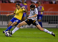 German defender (5) Annike Krahn tackles the ball away from Brazil forward (10) Marta. Germany (GER) defeated Brazil 2-0 in the finals of the Women's World Cup China 2007 at Shanghai Hongkou Football Stadium, Shanghai, China, on September 30, 2007.