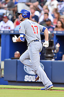 Chicago Cubs third baseman Kris Bryant (17) runs to first during a game against the Atlanta Braves on July 18, 2015 in Atlanta, Georgia. The Cubs defeated the Braves 4-0. (Tony Farlow/Four Seam Images)