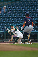 Fort Wayne TinCaps first baseman Chris Givin (4) stretches for a throw as Jonathan Aranda (8) of the Bowling Green Hot Rods steps on the base at Parkview Field on August 20, 2019 in Fort Wayne, Indiana. The Hot Rods defeated the TinCaps 6-5. (Brian Westerholt/Four Seam Images)