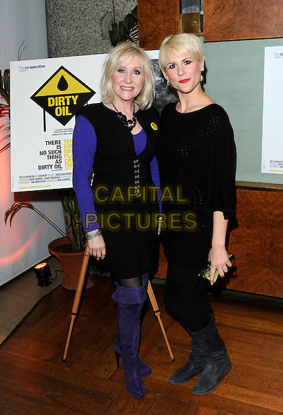 "CAROL HARRISON & GUEST.at the film premiere of ""Dirty Oil"", Barbican Centre, London, England, UK, 15th March 2010..full length black dress purple top knee high boots suede .CAP/FIN.©Steve Finn/Capital Pictures"