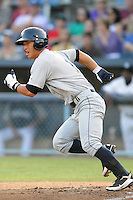 Charleston River Dogs right fielder Rob Refsnyder #11 runs to first during a game against the Asheville Tourists at McCormick Field on August 15, 2012 in Asheville, North Carolina. The Tourists defeated the River Dogs 6-0. (Tony Farlow/Four Seam Images).