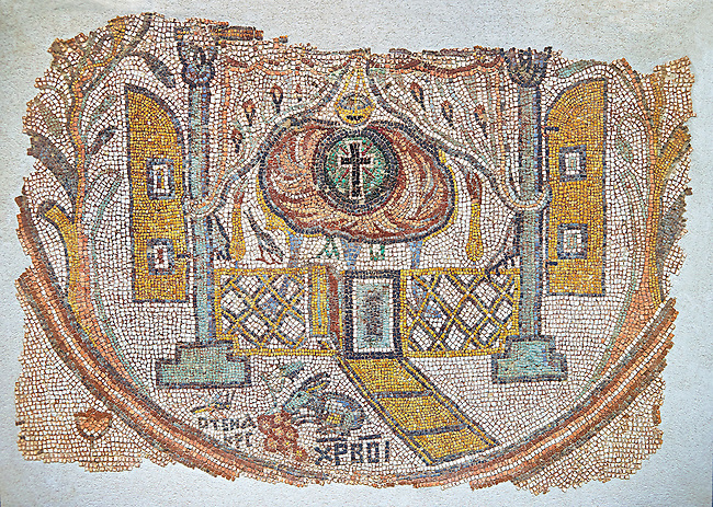 Roman mosaic of the inside of a church, Eastern Mediterranean, 5th century AD. This abstract representation of a church choir shows two columns, a low lattice  divider and a pair of oriental designed curtains at the top. beyond is the inner sanctum of the church with a Mandorla surrounded by flames with a cross in it. In the foreground is a a hare and devouring a bunch of grapes next to Greek letter that translate to 'Christ rescues'. Inv 5093, The Louvre Museum, Paris